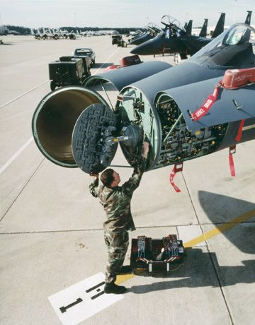 APG-63-all-weather-multimode-radar-being-serviced-in-the-nose-cone-of-an-F-15.jpg